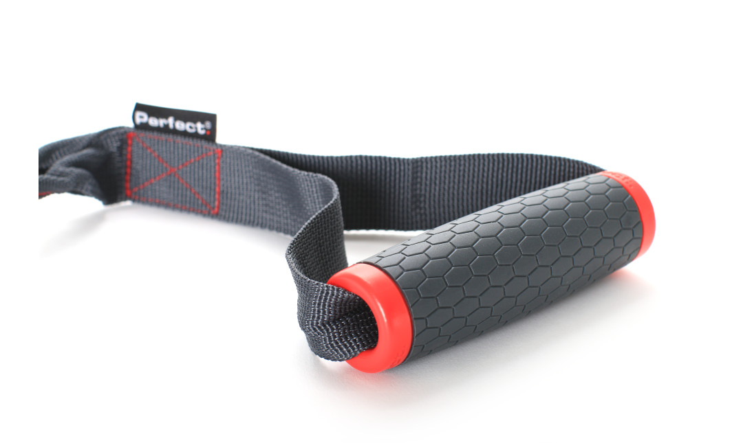 Close up of one Perfect Fitness Handle showing honeycomb pattern grip on handle
