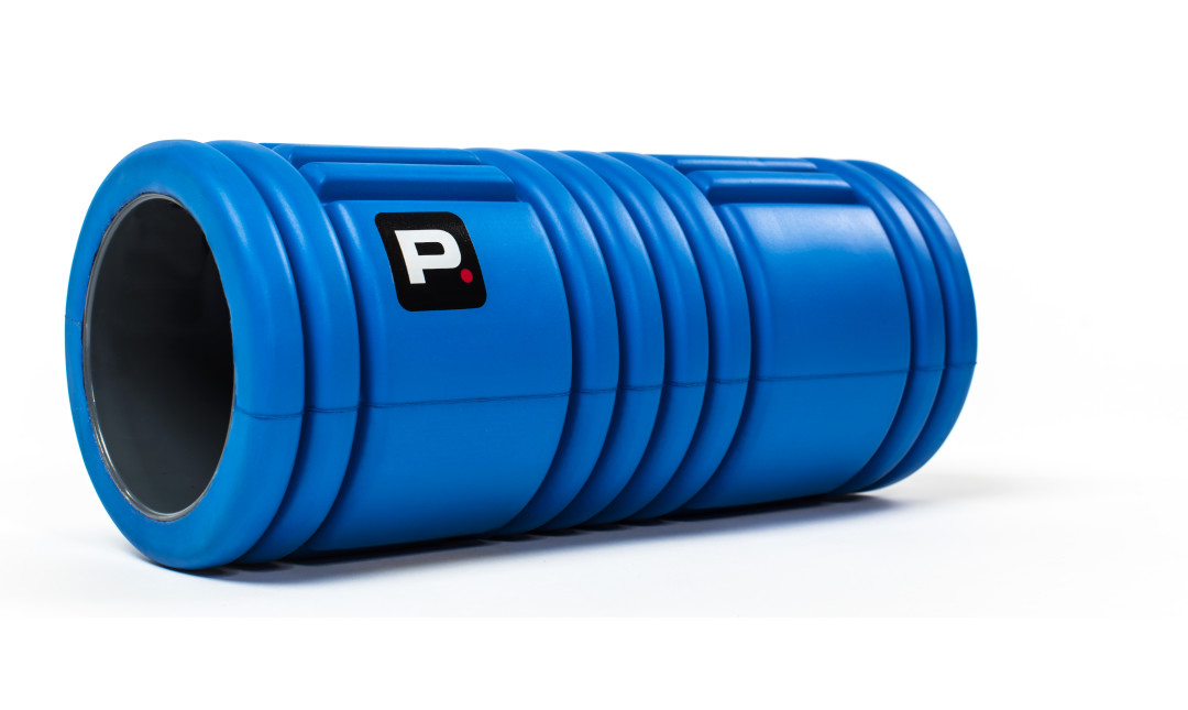 Blue Perfect Fitness foam roller laying diagonally on side in front of white background