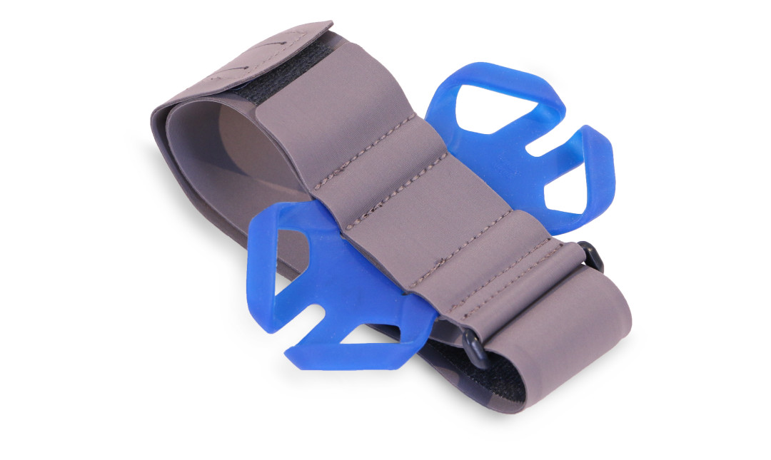 Perfect Fitness smartphone armband showing grey band, velcro closing, and blue silicon security straps